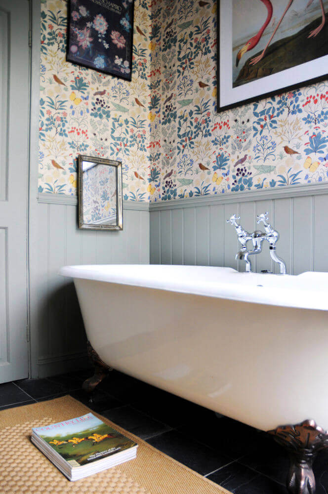 Bathtub in front of wallpapered wall