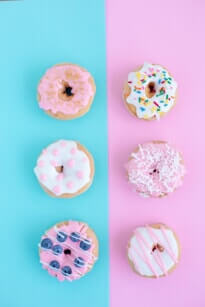blue and pink wall with iced donuts