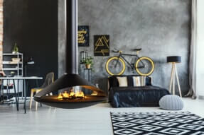 grey themed living space with unique fireplace installation