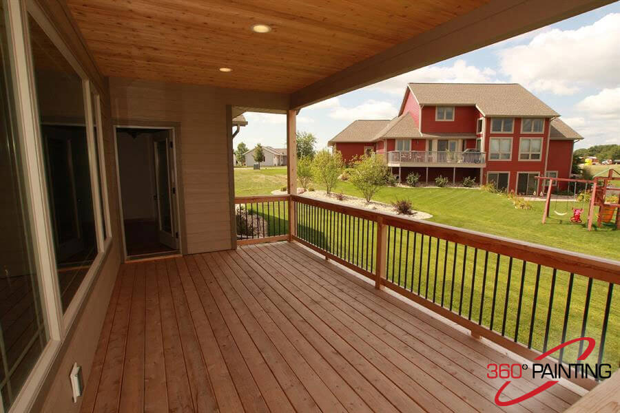 stained deck with covering and lighting