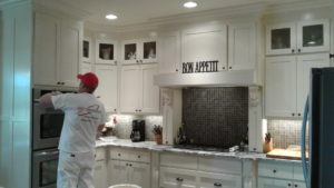 painting contractor in Bentonville touching up a kitchen